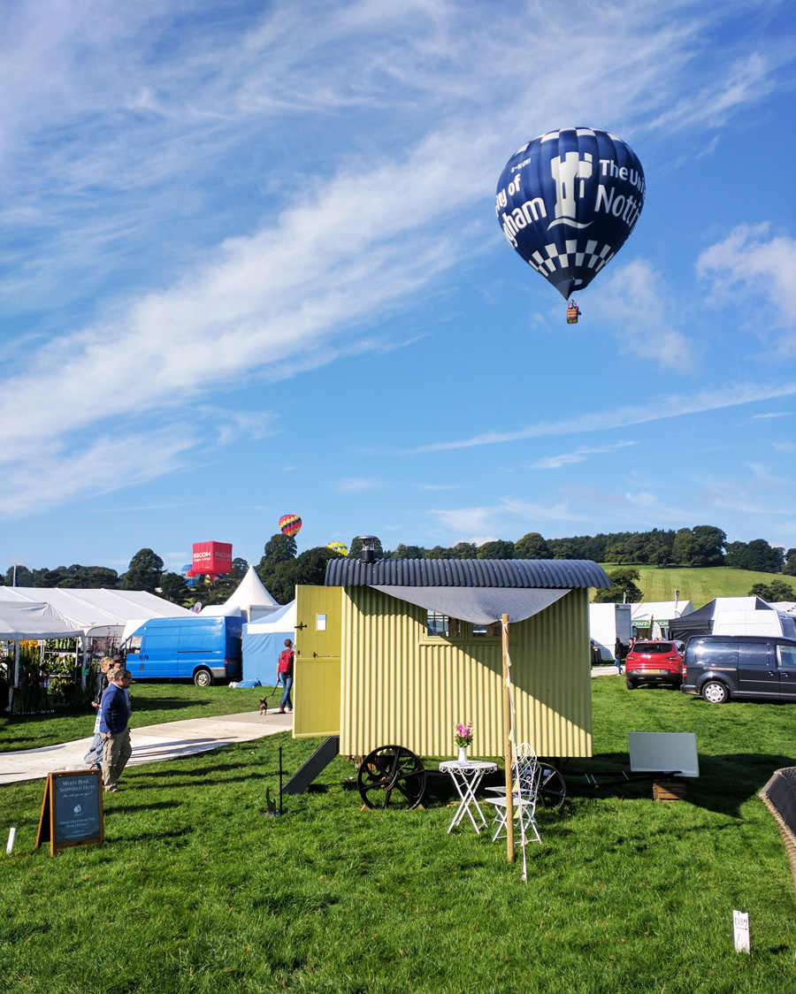 Hot air balloon float past shepherds hut