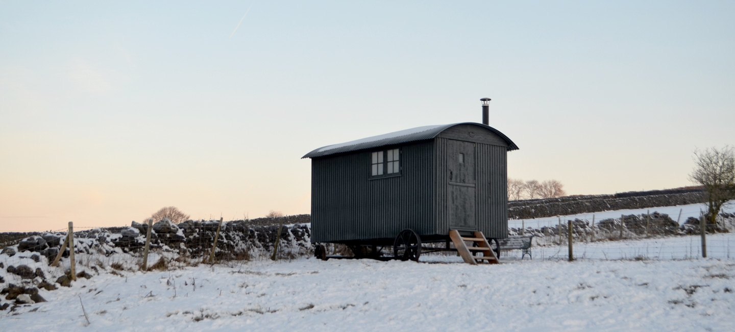 Shepherd hut in the snow