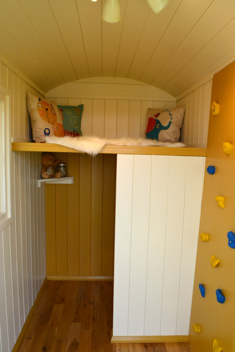 Yellow and cram shepherd hut for children